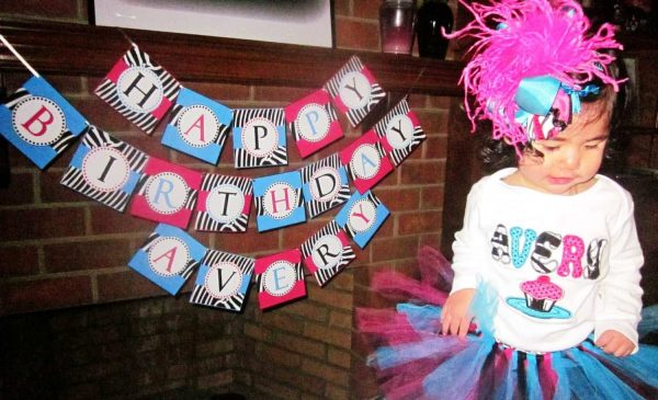 Here is the adorable little Avery with her birthday banner…Don't ...